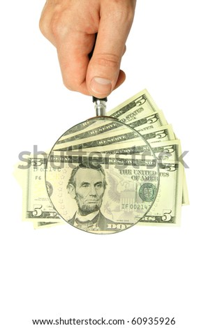dollar bill and hand holding magnifying glass isolated on white background