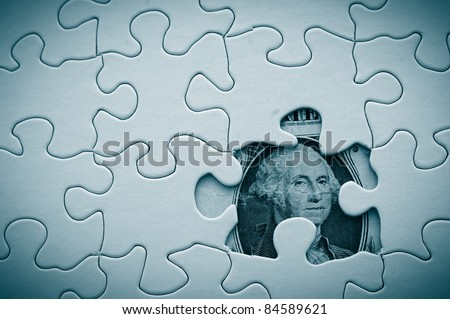 dollar bill and puzzle pieces