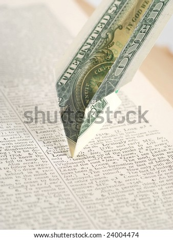 dollar bill as a paper airplane crashing into the word Loss