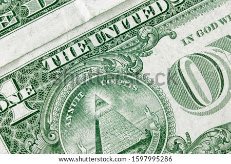 Dollar bill background with focus to masons logo on it. Freemasons and secret society concept.