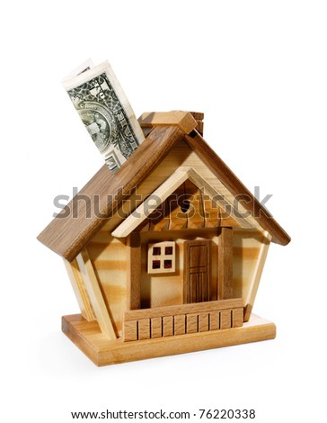 Dollar bill being deposited into a house money box. Investment, real estate, mortgage concept