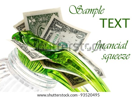 Dollar bills being squeezed in citrus press on white background with copy space.  Financial concept - Squeezing the most out of your money.