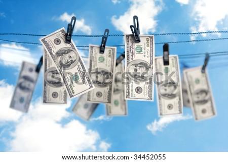 Dollar bills dry on a clothesline