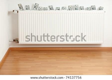 dollar bills inside a white radiator
