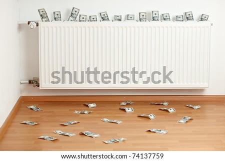 dollar bills inside a white radiator and on the floor