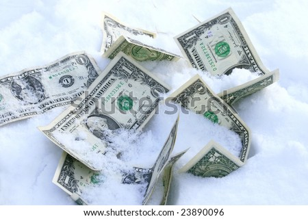 Dollar bills on the snow concept for frozen accounts