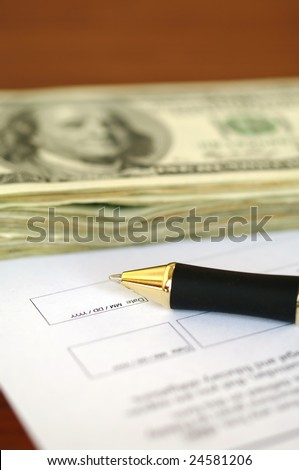 Dollar bills, pen and document page. See more in my portfolio.
