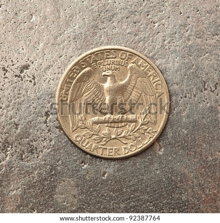 dollar coin on a metal surface