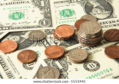 Dollar coins placed on dollar bills