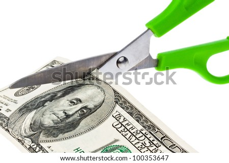dollar currency notes and scissors
