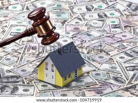 dollar currency notes, gavel and model building. housing crisis in america