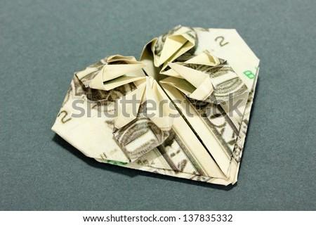 Dollar folded into shirt on blue background