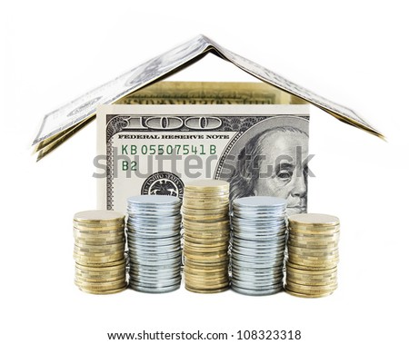 Dollar house with gold and silver coins isolated on white background. Concept