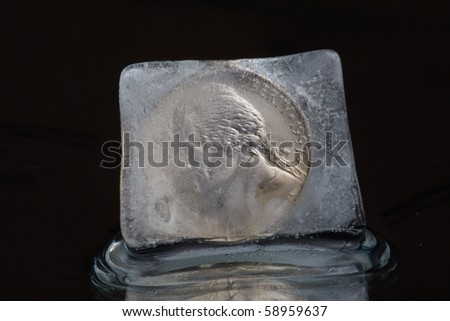 dollar in ice cube