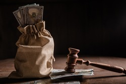 Dollar money bag and judge's gavel