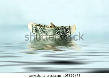 dollar ship in water - economy concept