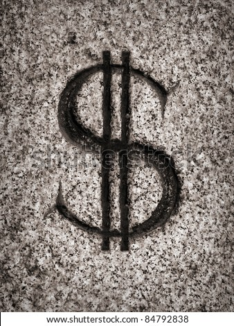 dollar sign on stone