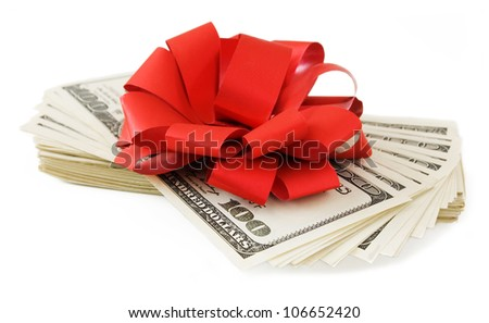 Dollar stack with red bow isolated on white background
