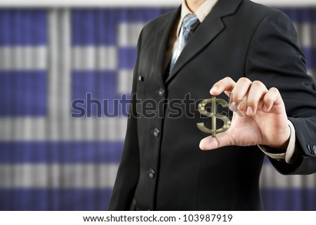 dollar symbol in businessman hand on Greece flag background