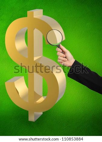 dollar symbol under a magnifying glass
