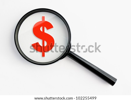dollar symbol under a magnifying glass, with isolated background
