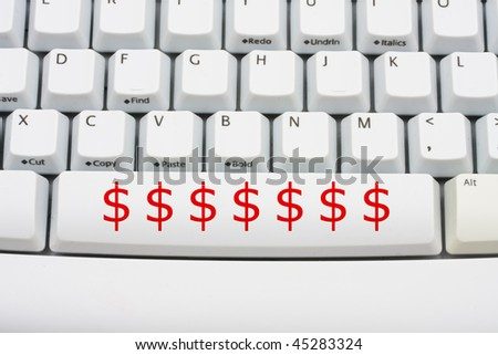 Dollar symbols in red on a computer keyboard, donate money online