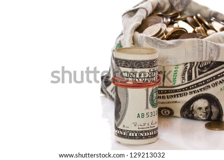 Dollars and coins in money bag on a white background