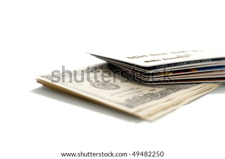 Dollars and credit card. Shallow DOF - stock photo