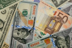 dollars and euros. Background from different banknotes, different denominations. paper money, currency, cash Dollars, euros. close-up. finance, payment, trade, financial transactions concepts