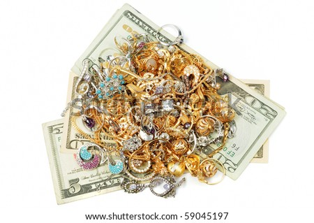 Dollars and gold jewerly on white background