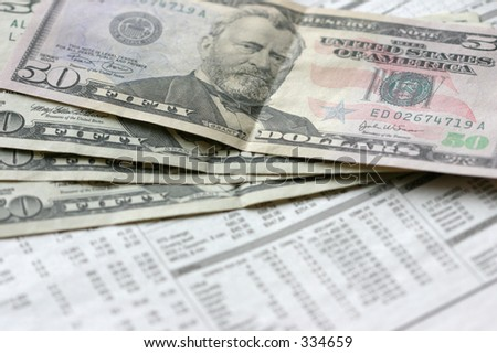 Dollars and newspaper