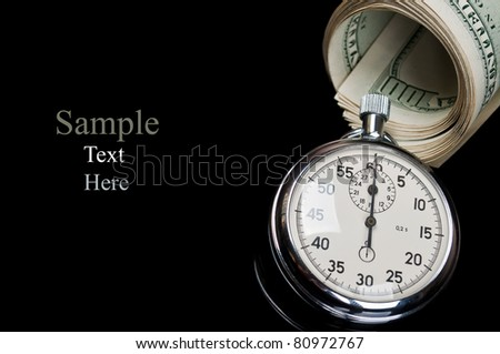 dollars and stopwatch isolated on a black background