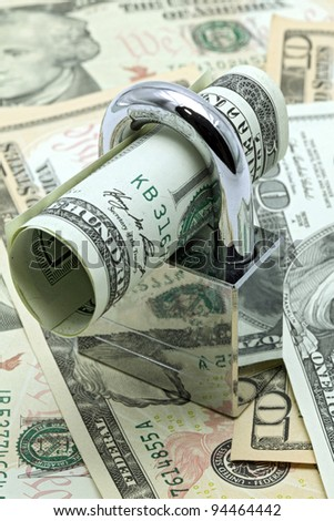 Dollars Banknote bills Locked on Cash background for Money Saving Insurance Concept