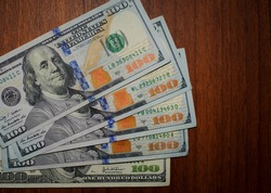 dollars banknotes on the table, close-up. U.S. dollars. 500 American dollars. paper money, currency, cash. concepts of finance, payments, commerce, financial transactions, prosperity. background