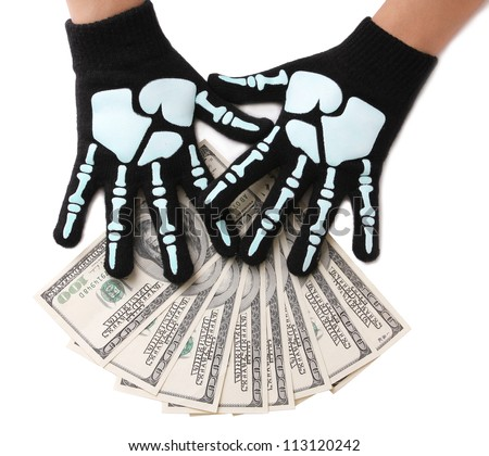 dollars bills and skeleton hands isolated on white, money