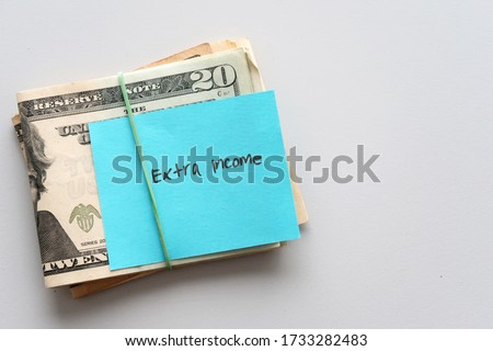Dollars cash money and paper note with text written SIDE HUSTLE on copy space background - concept of financial planning - make more extra money from parttime side hustle or second job ストックフォト ©
