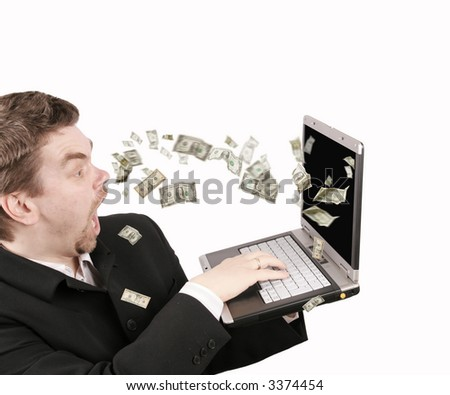 Dollars coming out from a laptop