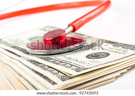 dollars consulted with a red stethoscope close-up on white background
