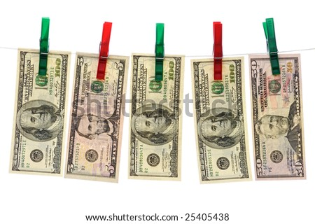 Dollars hanging on red and green clotheslines isolated on white background