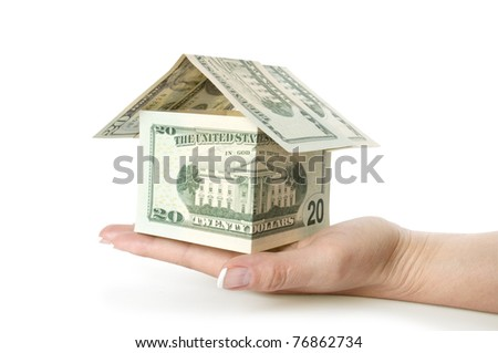 dollars house in hand isolated on white