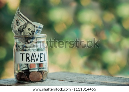 Dollars in a glass jar. Savings for travel. #1111314455