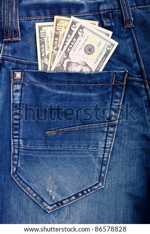 Dollars in blue jeans back pocket