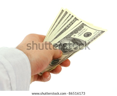 Dollars in hand on white