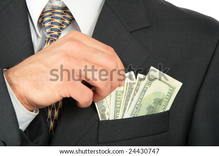 Dollars in pocket of coat and hand
