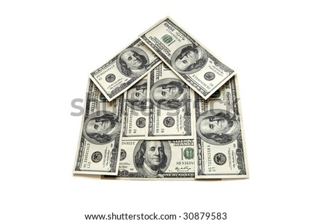 dollars, lyings as a cottage on a white background
