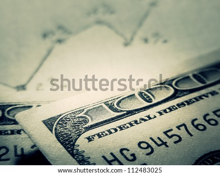 Dollars on hand drawn chart. Business concept. Toned image.