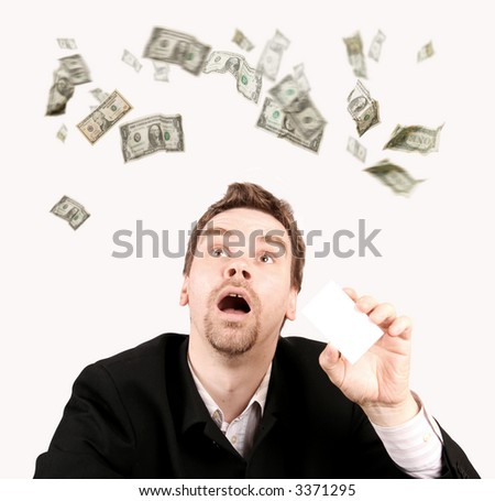 Dollars raining on a man with a blank card in his hand