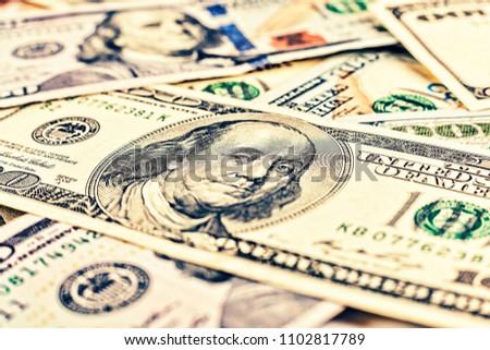 Dollars USA. Background of 100 dollar bills. A lot of dollar bills scattered on a white background. Money concept. financial concept. money background from dollars usa