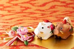 Dolls of boar. Japanese new year card.