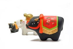 Dolls of Cow. Japanese new year card. Japanese New Year Cow object. Note: Japanese word of this photography means